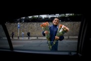 7a Avenue flower vendor in Bogotá, Colombia. ..Photo by Robert Caplin.